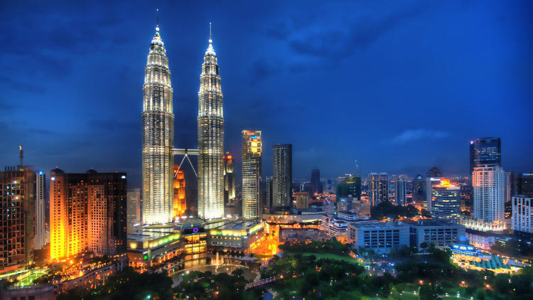 Flying Through the Night Skies of Kuala Lumpur by Trey Ratcliff on Flickr flic.kr/p/9tHgDm
