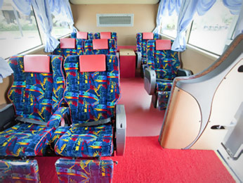 Wider seat on bus with 3 seats in a row configuration